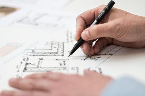 dessin d'un plan de maison par un architecte